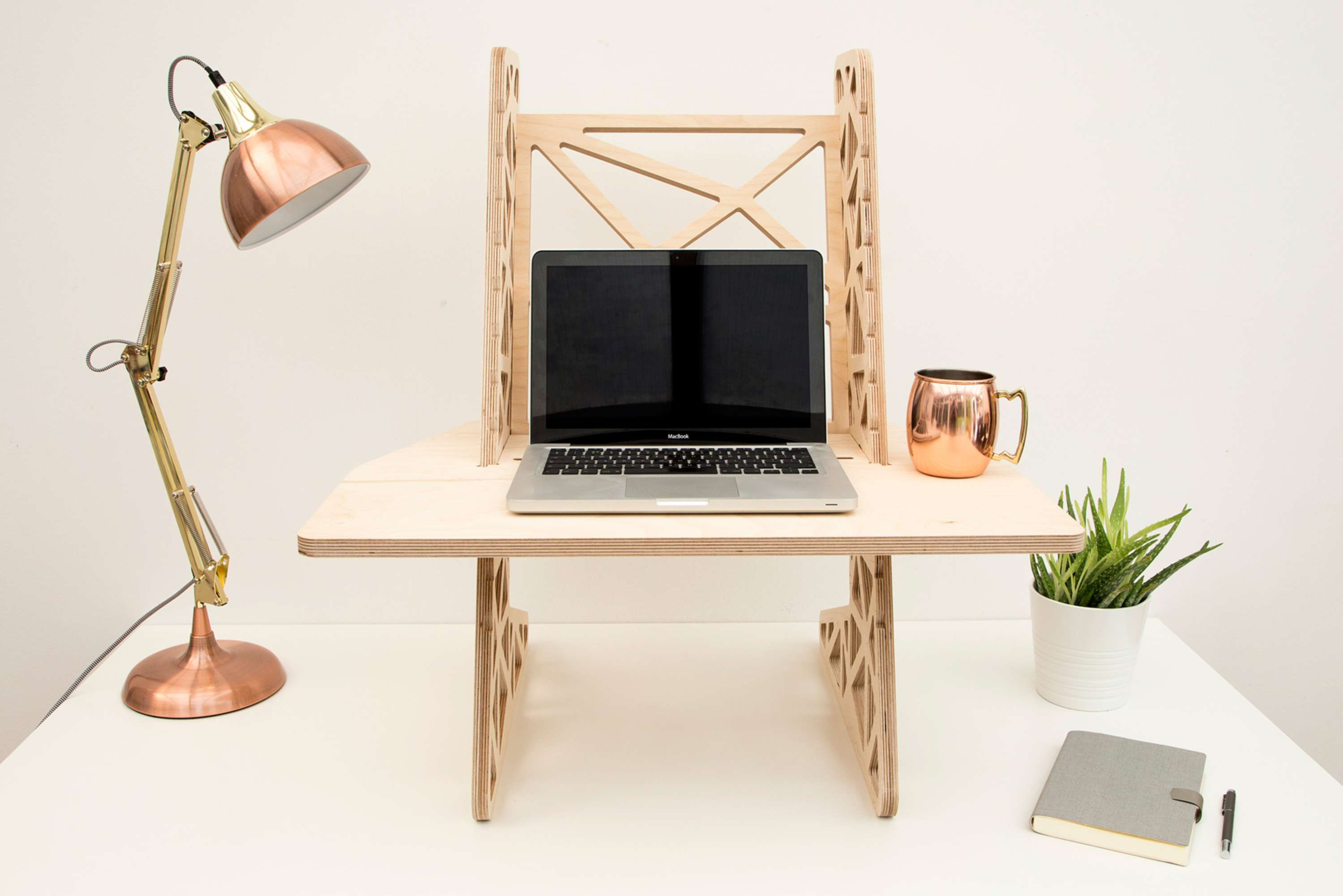 Design Develop And Ion Of Standing Desk Converters Portable Laptop Stands For Helmm Produced In The Uk Using Sustainable Plywood Precision Cnc Cut