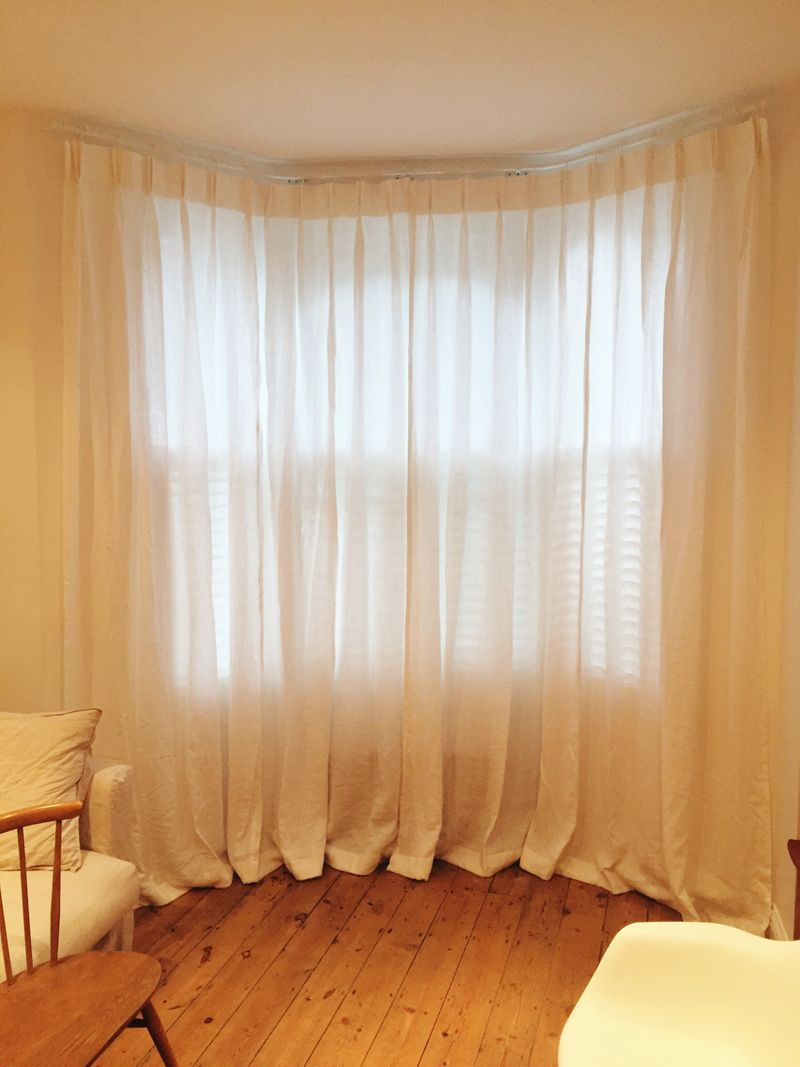 Sheer pinch pleat curtains and relaxed Roman blinds