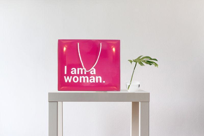 I AM A WOMAN.