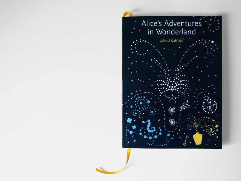 "The story ""Alices Adventures in Wonderland"" written by Lewis Carrol"